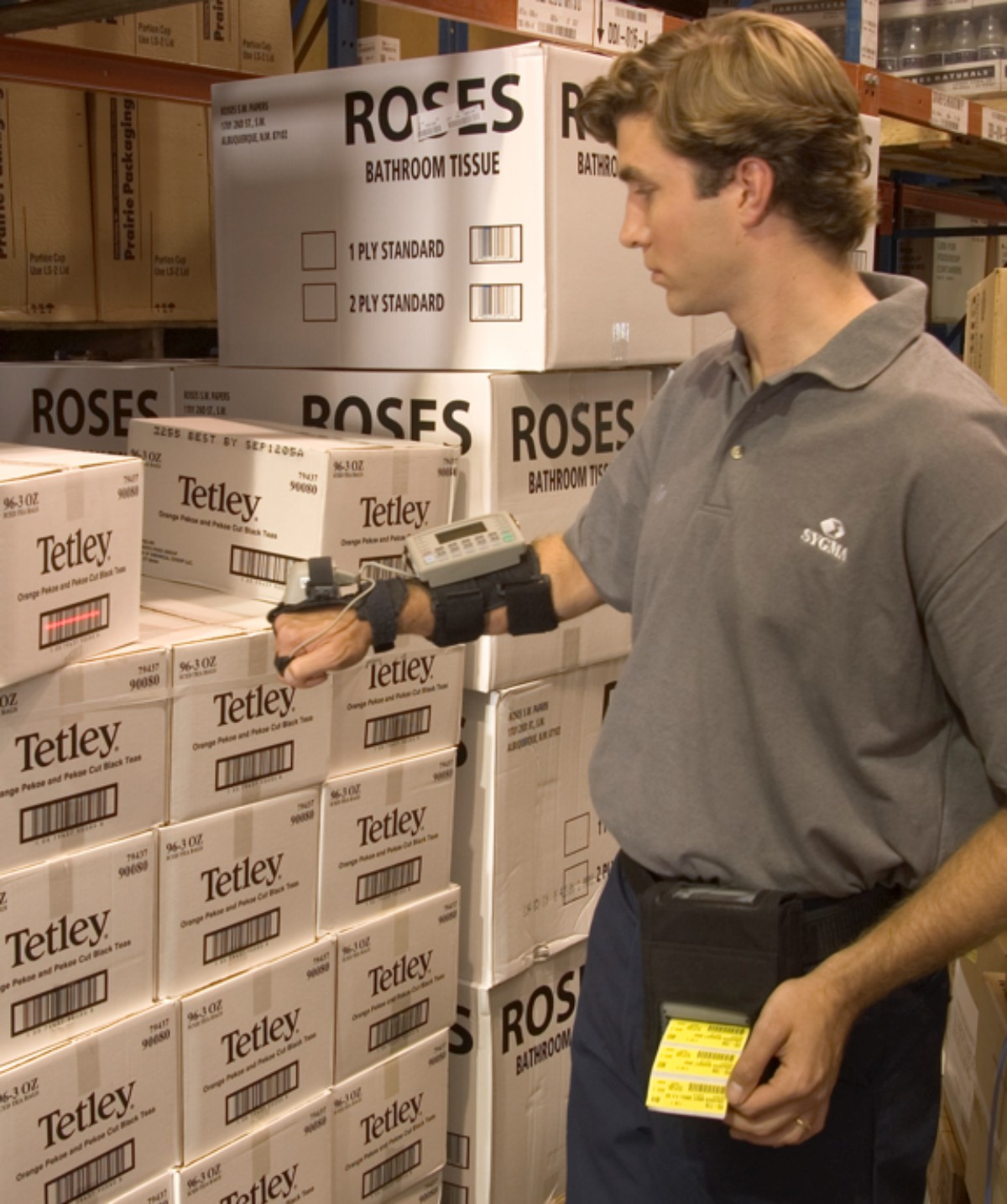SYGMA warehouse worker inspecting boxes